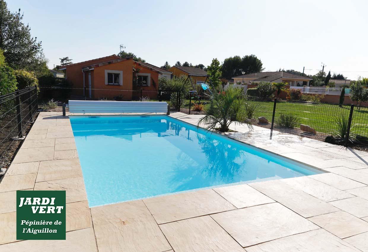 Création d'une piscine avec tour de piscine terrasse dallée à Muret - Jardi Vert, piscinier Toulouse