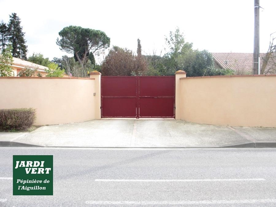 Construction de murs en parpaing avec pose de brique brique foraine, pose d'un portail et enduit de couleur à Frouzins